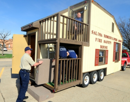 Salina fire department receives new fire safety house for Fire safety house